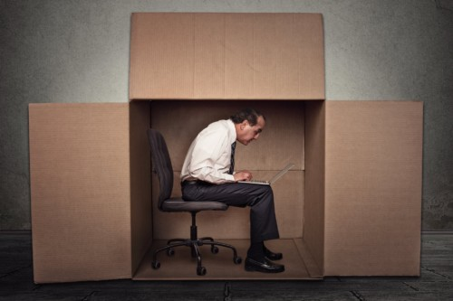 Man Sitting in a Box